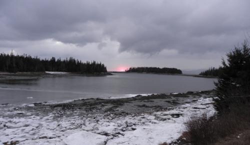 setting sun in grey sky